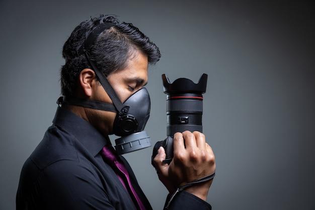 Photographer closing his eyes pandemic mask protecting himself from the coronavirus