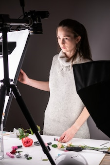 Photographer in an equipped photo studio preparing for the shooting