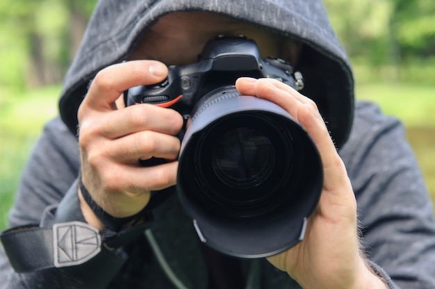 Photographer hidden with the camera.
