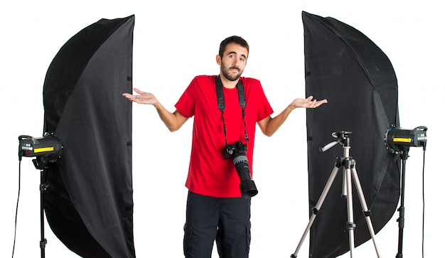 Photographer in his studio having doubts