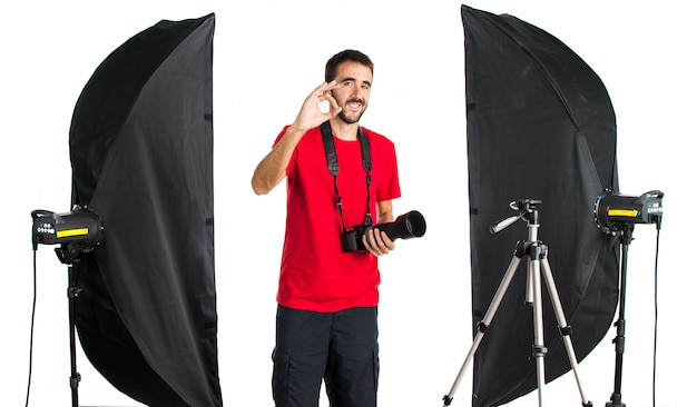 Photographer in his studio making ok sign