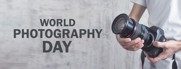 Photographer holding camera. world photography day