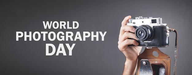 Photographer holding old camera. world photography day