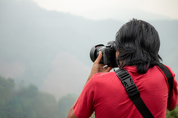 The photographer is photographing the mountain on his travels.