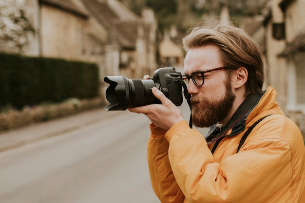 Photographer man taking photos in the village