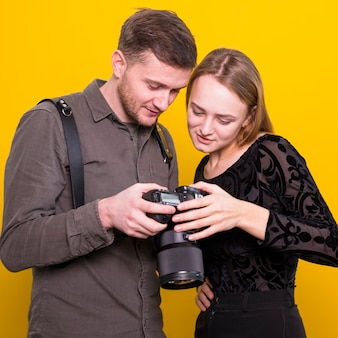 Photographer and model checking pictures on camera