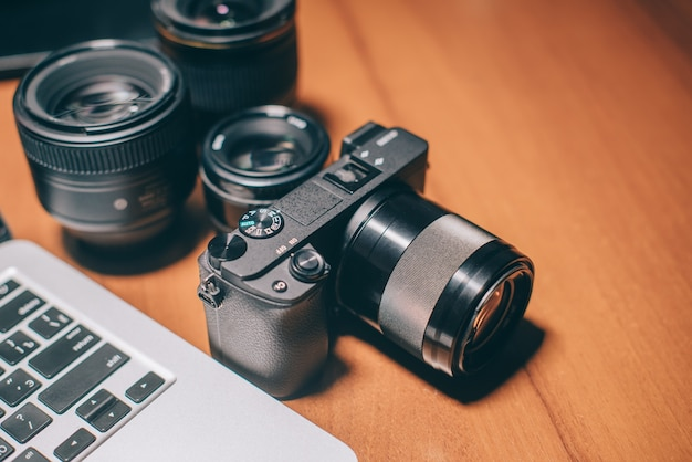Photographer's tools lie on his desktop, close-up
