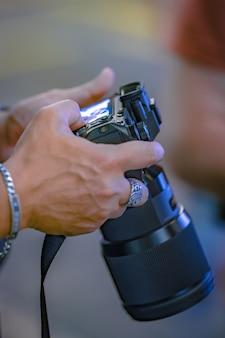 Photographer setting a camera