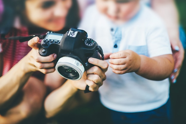 Photographer showing small child photos on the camera