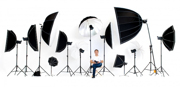Photographer sit on the director's chair with flash studio lights