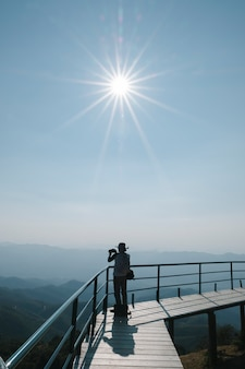 Photographer under sun in daylight