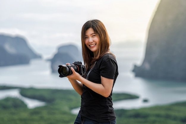 Photographer or the tourist over the fantastic landscape of samed nang chee view point