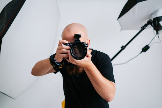 An photographer with camera in studio