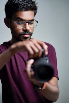 Photographer with camera on white background.