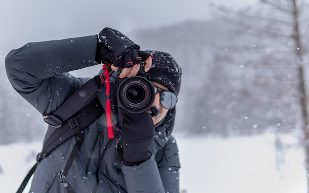 Photographer with falling snow background