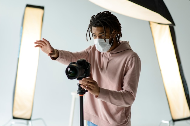 Photographer with medical mask