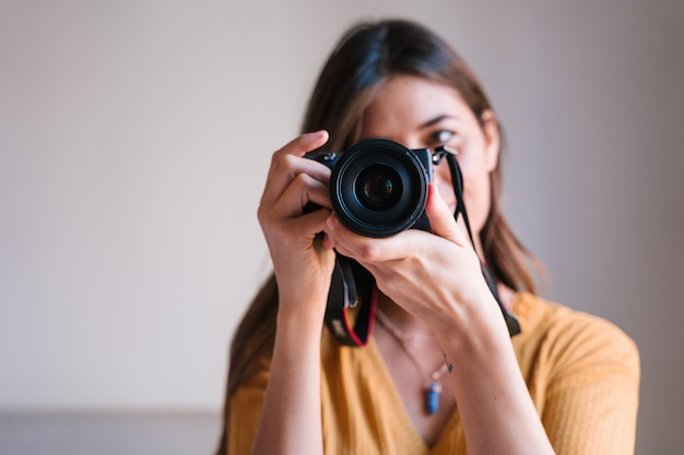 Photographer woman at home using a reflex camera