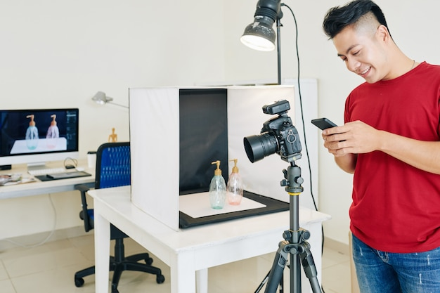 Photographer working at home studio