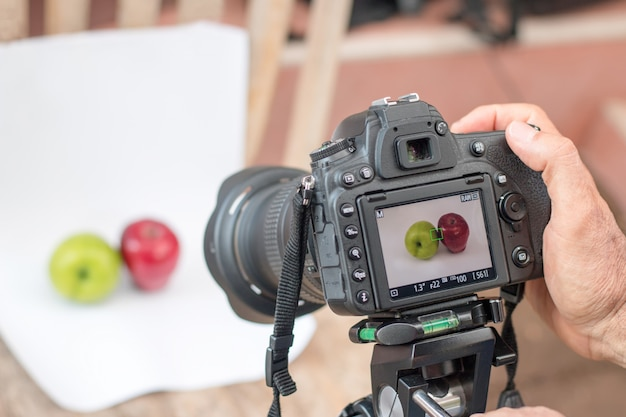 Photographers are using dslr camera shooting fruit on white background select focus camera