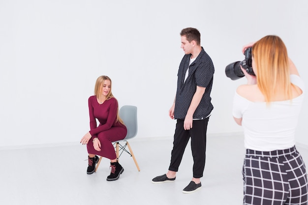 Photographers and models taking photos in a studio