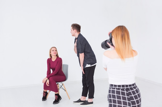 Photographers and models working in a studio