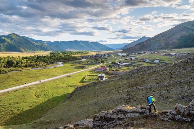 Photographertraveler on hillside russia mountain altai village of bichiktuboom