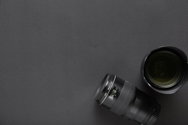 Photography concept with camera lenses on black background and copy space