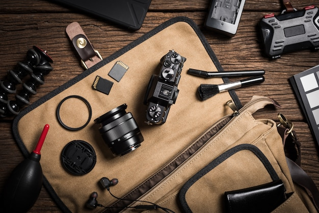 Photography gear on wooden table
