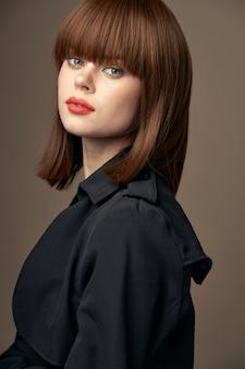 Photography studio pretty brunette european appearance black coat