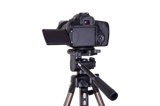 Photography and videography concept  dslr camera with blank screen on tripod isolated on white