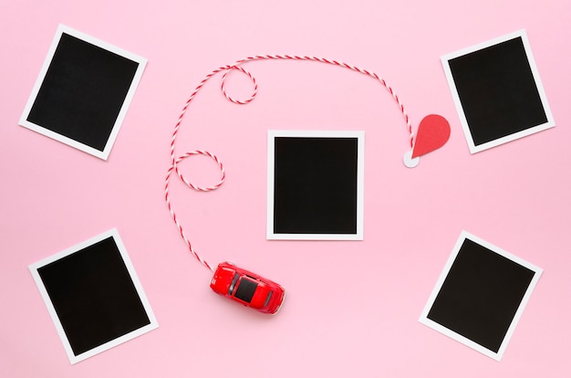 Photos collection with car toy on table