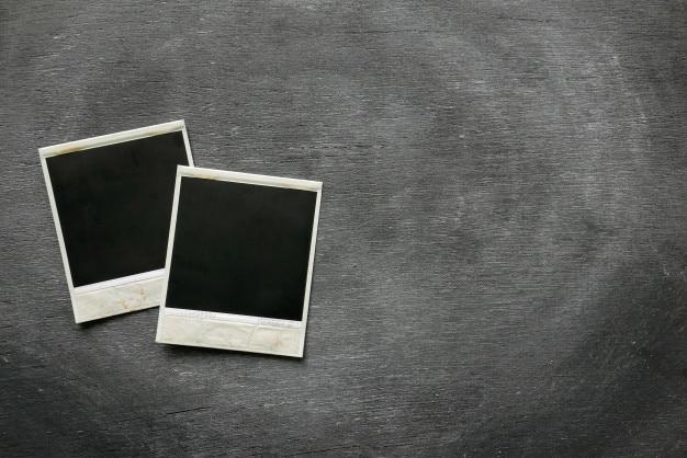 Photos frame of polaroid on black background.