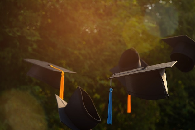 Photos of the graduates' hats on the background are bokeh blurred.