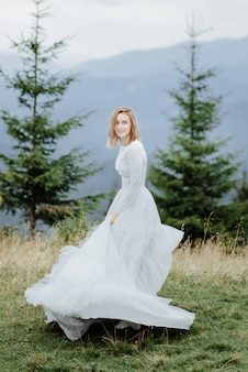 Photoshoot of the bride in the mountains. boho style wedding photo.