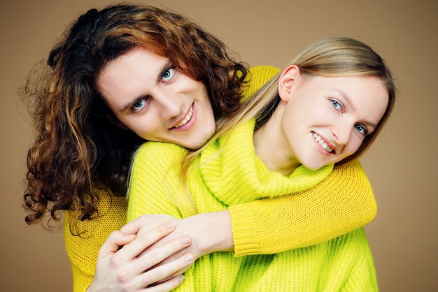 Photoshot of young beautiful couple in love hugging. guy said how lucky he is to have such smart and