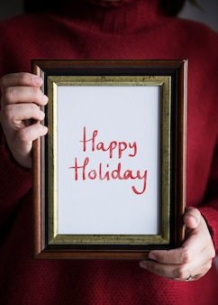 Frase happy holiday in a frame