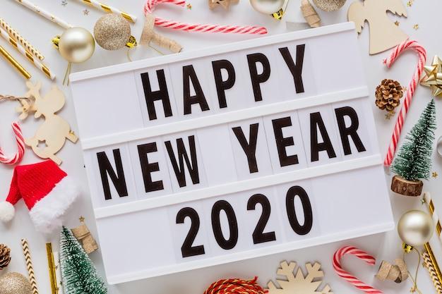 Phrase happy new year 2020 on lightbox
