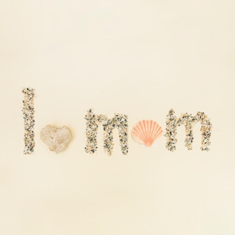 Phrase i love you mom made of sand and shell