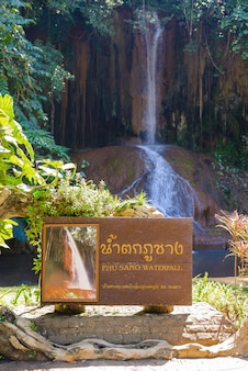 Phu sang waterfall with water only in thailand. -36 to 35 degree celsius water temperatures that flows from a limestone cliff 25 meters high.