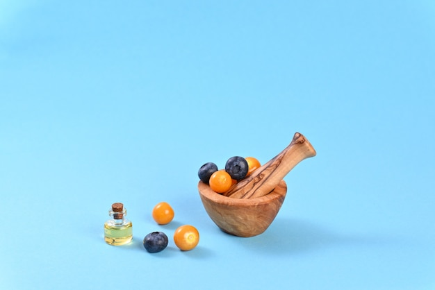 Physalis and blueberries in spice mortar