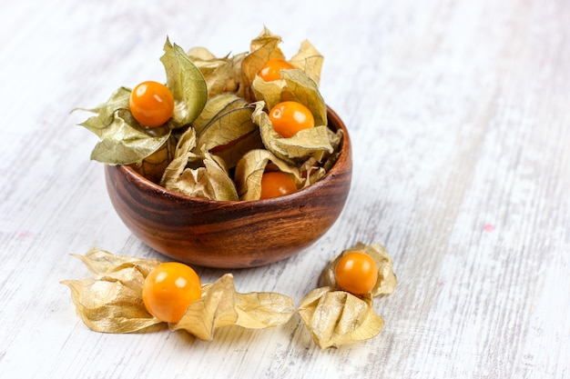 Physalis on a clay dish. ripe berries of autumn physalis fruit