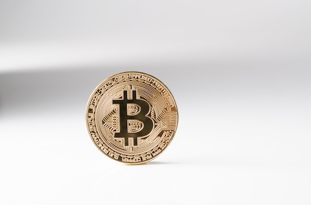 Physical gold bitcoin coin on a white background. new worldwide cryptocurrency.