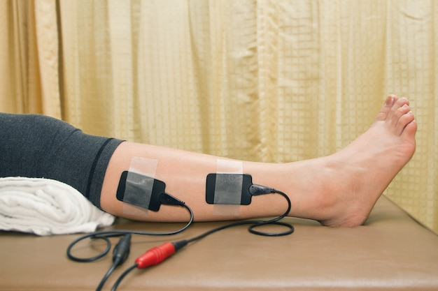 Physical therapy,woman with eletrical stimulator