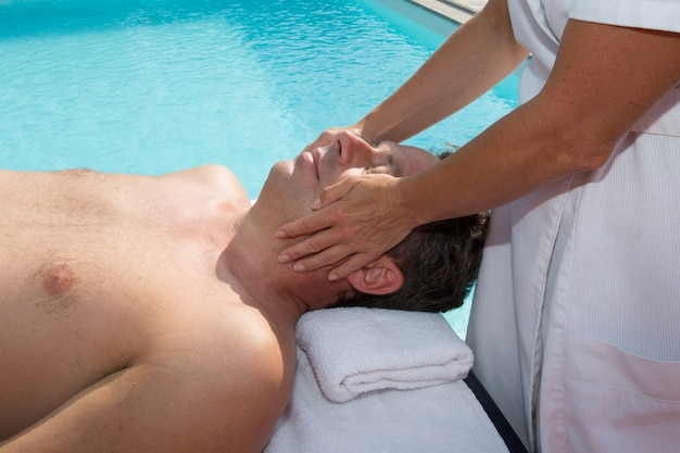 Physiotherapist doing a massage on face