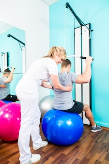 Physiotherapist doing sport rehabilitation with patient