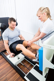Physiotherapist exercising patient in sport therapy