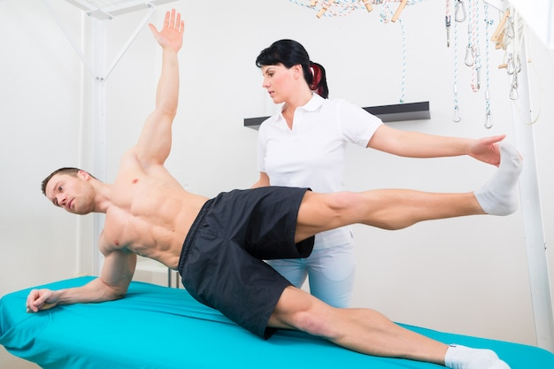 Physiotherapist exercising with patient in practice
