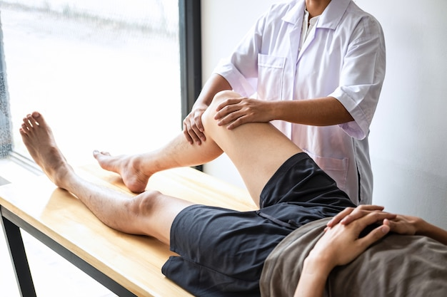 Physiotherapist treating the leg of a patient