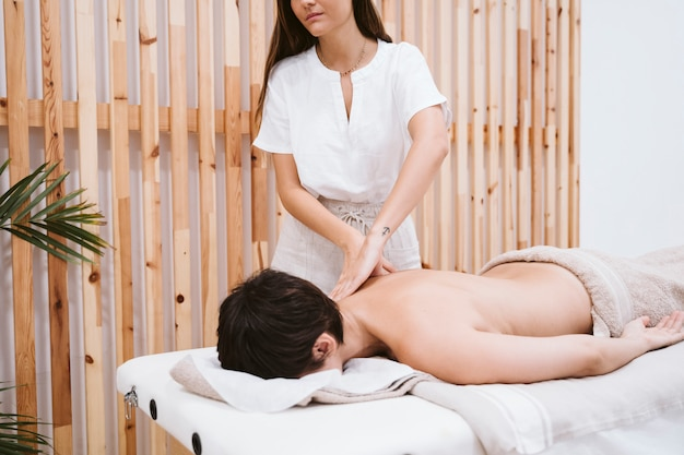 Physiotherapist woman working in clinic with female patient