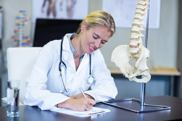 Physiotherapist writing a report